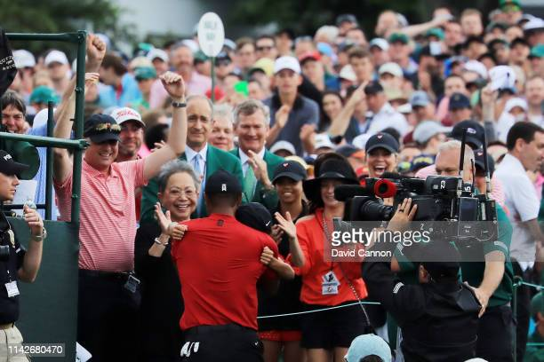 Tiger Woods of the United States celebrates with his son Charlie Axel his mother Kultida and daughter Sam Alexis as he leaves the 18th green after...