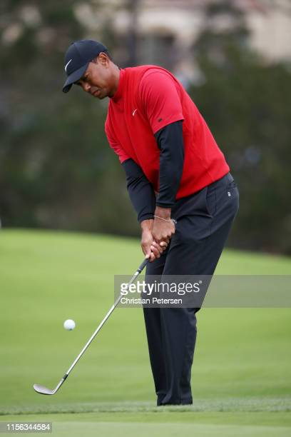 Tiger Woods of the United States chips to the green on the sixth hole during the final round of the 2019 U.S. Open at Pebble Beach Golf Links on June...