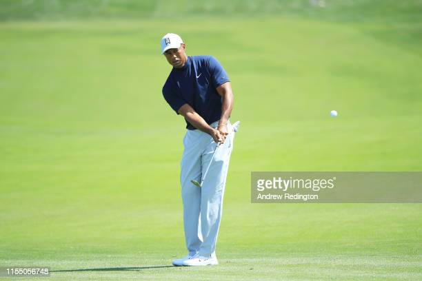 Tiger Woods of the United States chips to the sixth green during a practice round prior to the 2019 U.S. Open at Pebble Beach Golf Links on June 10,...