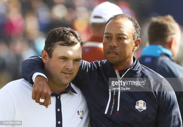 Tiger Woods of the United States consolls Patrick Reed of the United States following defeat during the morning fourball matches of the 2018 Ryder...