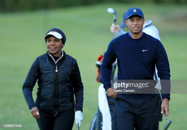 Tiger Woods of the United States enjoys a light hearted moment with former United States Secretary of State Condoleezza Rice during the proam for the...