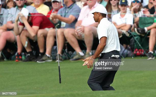 Tiger Woods of the United States flips his putter after missing a channce for birdie on the 14th hole during the second round of the 2018 Masters...