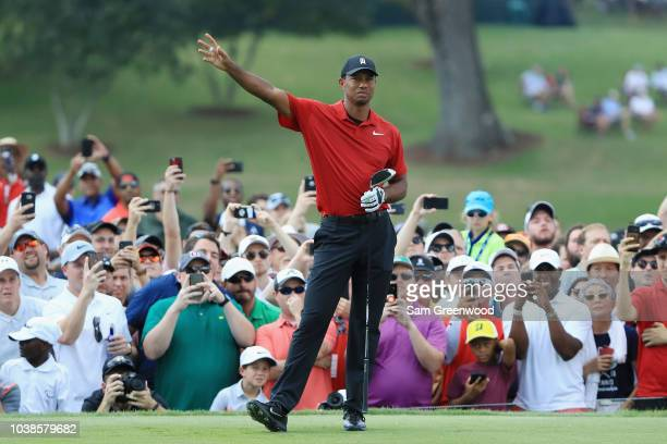 Tiger Woods of the United States gestures after playing his shot from the fourth tee during the final round of the TOUR Championship at East Lake...