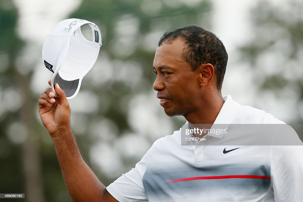 Tiger Woods of the United States gestures to the crowd after the first round of the 2015 Masters Tournament at Augusta National Golf Club on April 9, 2015 in Augusta, Georgia.
