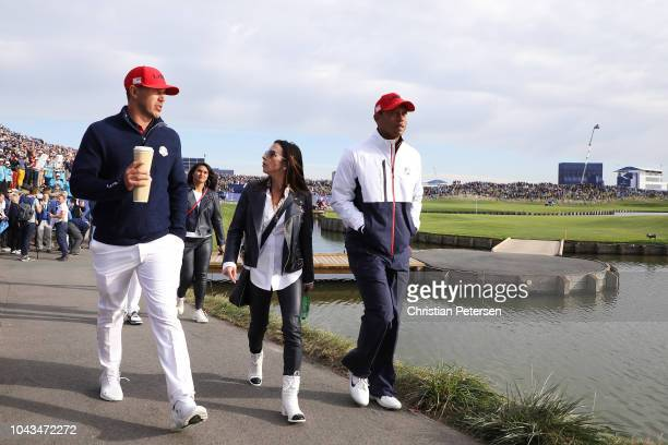 Tiger Woods of the United States girlfriend Erica Herman and Brooks Koepka of the United States during singles matches of the 2018 Ryder Cup at Le...