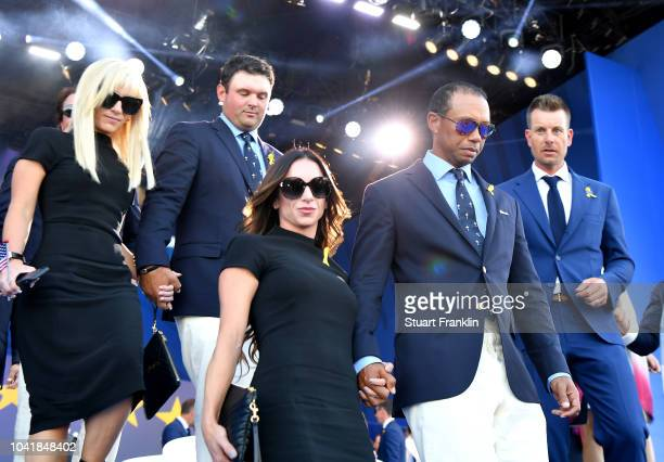 Tiger Woods of the United States, girlfriend Erica Herman, Patrick Reed of the United States and wife Justine Reed depart the opening ceremony for...