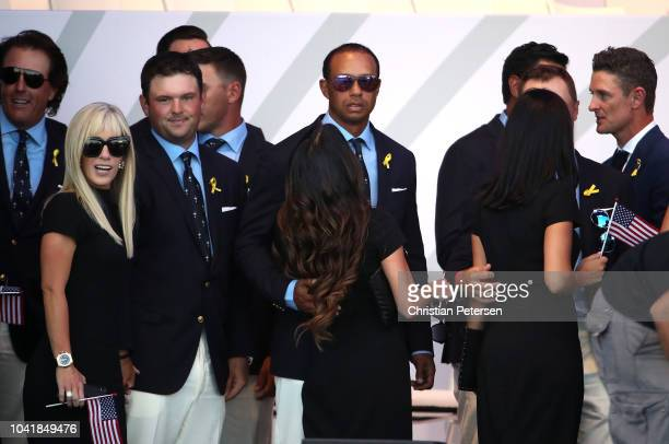 Tiger Woods of the United States girlfriend Erica Herman Patrick Reed of the United States and wife Justine Reed depart the opening ceremony for the...