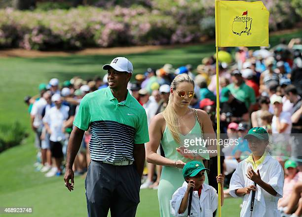Tiger Woods of the United States his girlfriend Lindsey Vonn son Charlie and daughter Sam look on during the Par 3 Contest prior to the start of the...