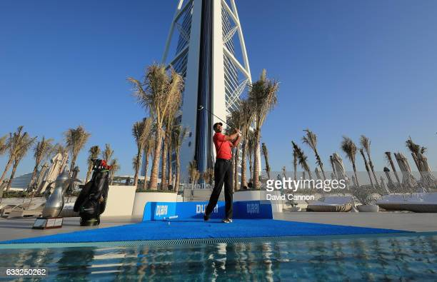 Tiger Woods of the United States hits a ball into the Arabian Gulf from the Terrace of the Burj Al Arab ahead of the 2017 Omega Dubai Desert Classic...