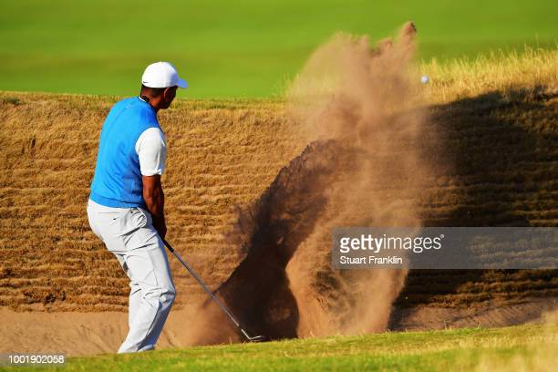 US golfer Tiger Woods watches his iron shot from the 3rd tee during his first round on day one of The 147th Open golf Championship at Carnoustie...
