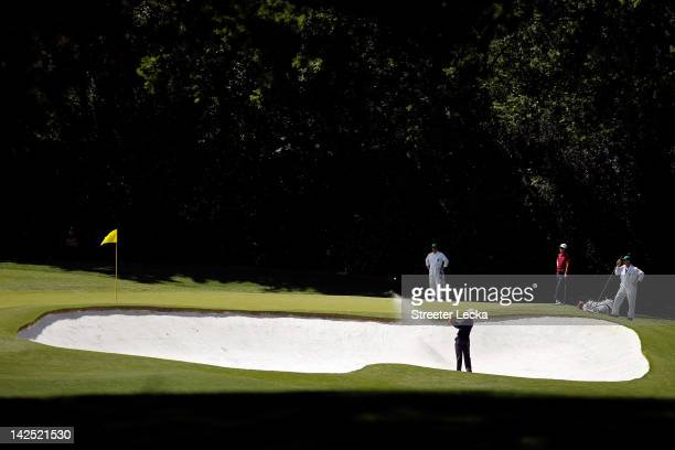 Tiger Woods of the United States hits a bunker shot on the fourth hole during the second round of the 2012 Masters Tournament at Augusta National...