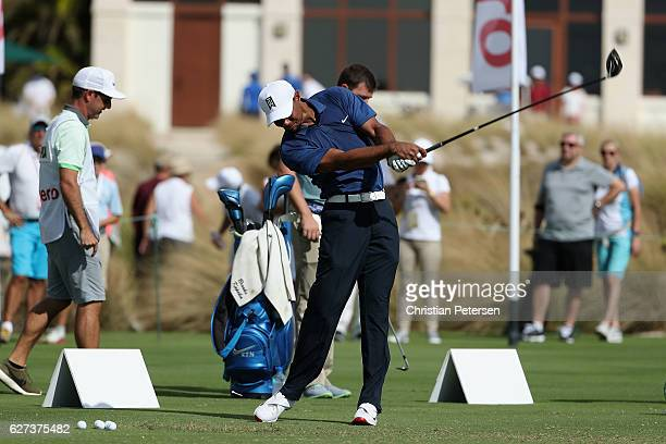 Tiger Woods of the United States hits a driver on the practice range before round two of the Hero World Challenge at Albany, The Bahamas on December...