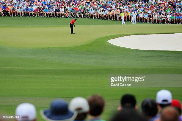 Tiger Woods of the United States hits a putt on the second green during the final round of the 2015 Masters Tournament at Augusta National Golf Club...