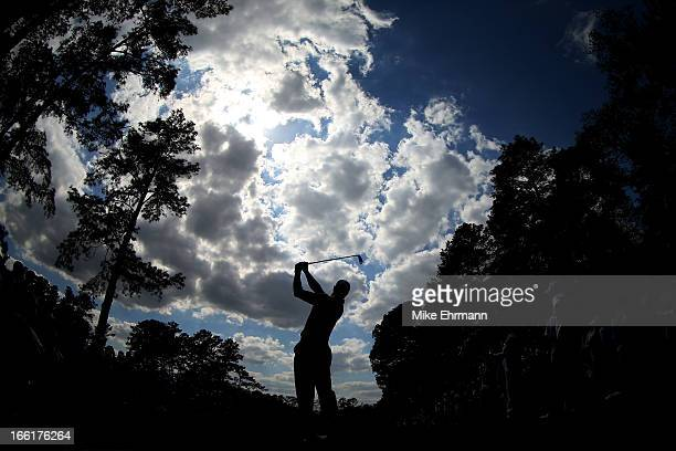 Tiger Woods of the United States hits a shot during a practice round prior to the start of the 2013 Masters Tournament at Augusta National Golf Club...