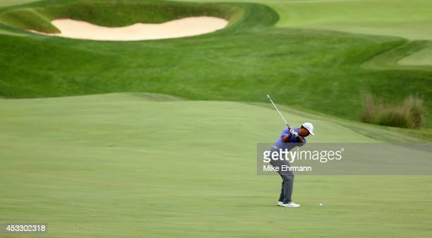 Tiger Woods of the United States hits a shot on the 18th hole during the first round of the 96th PGA Championship at Valhalla Golf Club on August 7...