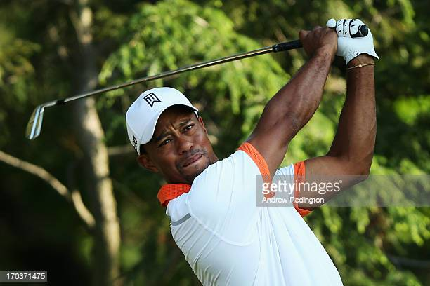 Tiger Woods of the United States hits a tee shot during a practice round prior to the start of the 113th U.S. Open at Merion Golf Club on June 12,...