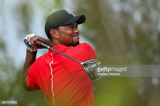 Tiger Woods of the United States hits a tee shot on the 11th hole during the final round of the Hero World Challenge at Albany The Bahamas on...