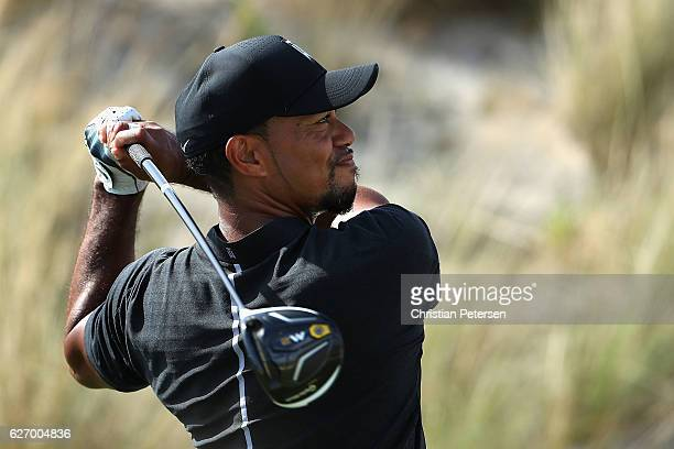 Tiger Woods of the United States hits a tee shot on the third hole during round one of the Hero World Challenge at Albany The Bahamas on December 1...
