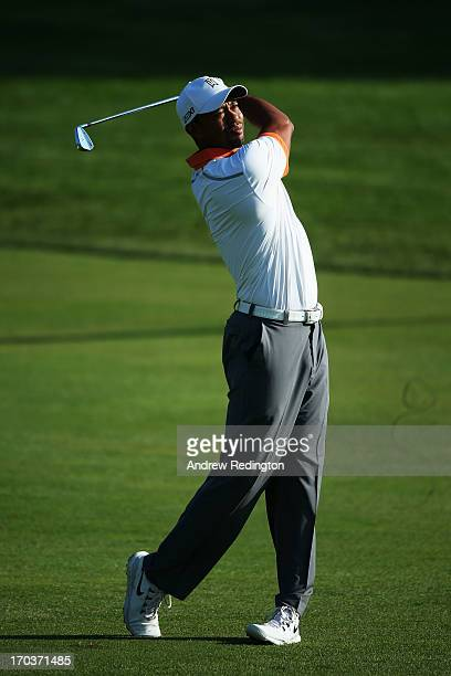 Tiger Woods of the United States hits an approach shot during a practice round prior to the start of the 113th U.S. Open at Merion Golf Club on June...