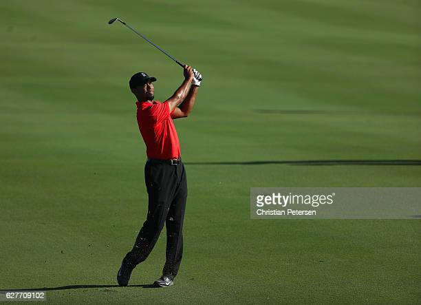 Tiger Woods of the United States hits an approach shot on the 18th hole during the final round of the Hero World Challenge at Albany The Bahamas on...