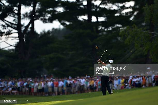 Tiger Woods of the United States hits an approach shot on the fifth hole during Round Three of the 113th U.S. Open at Merion Golf Club on June 15,...