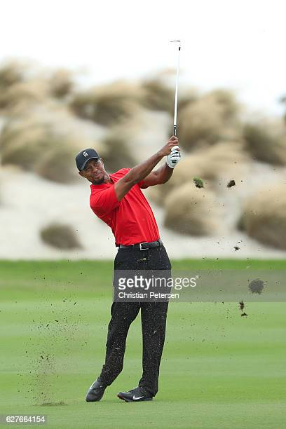 Tiger Woods of the United States hits an approach shot on the third hole during the final round of the Hero World Challenge at Albany The Bahamas on...
