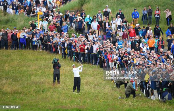 Tiger Woods of the United States hits an approach shot out of the rough during the second round of the 148th Open Championship held on the Dunluce...