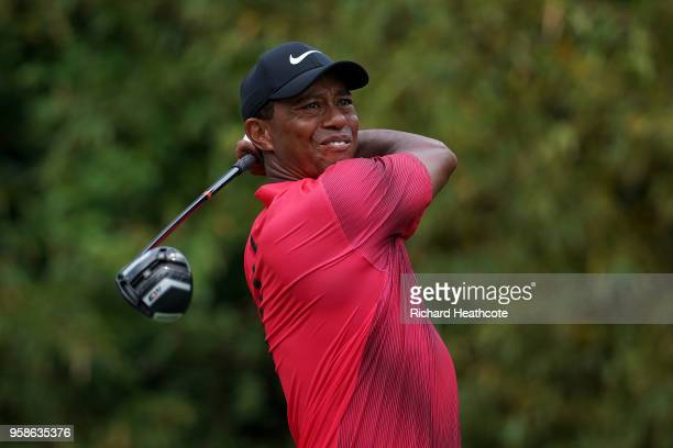 Tiger Woods of the United States hits driver off the 11th tee during the final round of THE PLAYERS Championship on the Stadium Course at TPC...