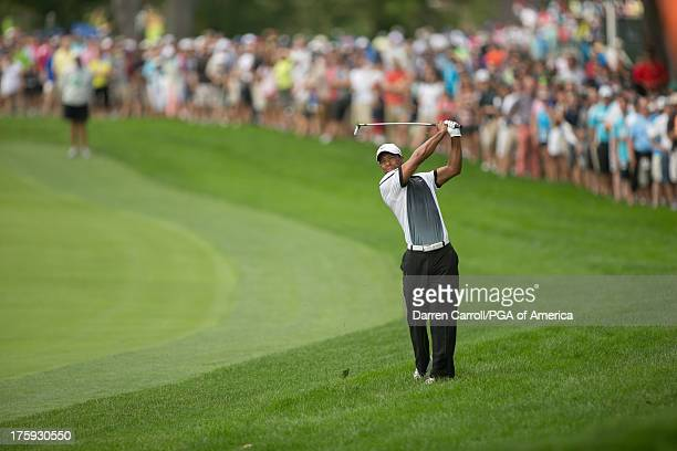 Tiger Woods of the United States hits his 2nd shot on 2 during the third round of play at the 95th PGA Championship at Oak Hill Country Club on...