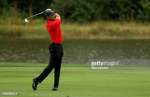 Tiger Woods of the United States hits his approach shot on the 15th hole during the final round of the PNC Championship at the Ritz Carlton Golf Club...