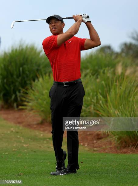 Tiger Woods of the United States hits his approach shot on the 16th hole during the final round of the PNC Championship at the Ritz Carlton Golf Club...