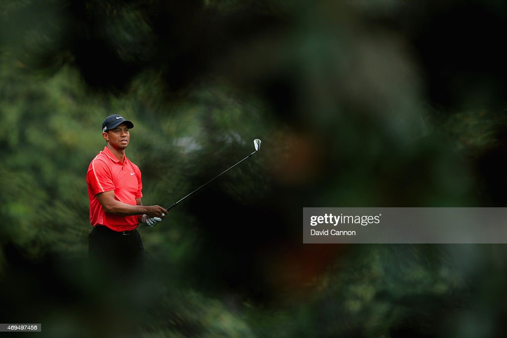 Tiger Woods of the United States hits his approach shot on the fifth hole during the final round of the 2015 Masters Tournament at Augusta National Golf Club on April 12, 2015 in Augusta, Georgia.