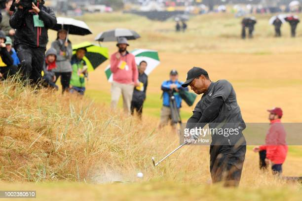 Tiger Woods of the United States hits his second shot from the rough on the second hole during the second round of the 147th Open Championship at...