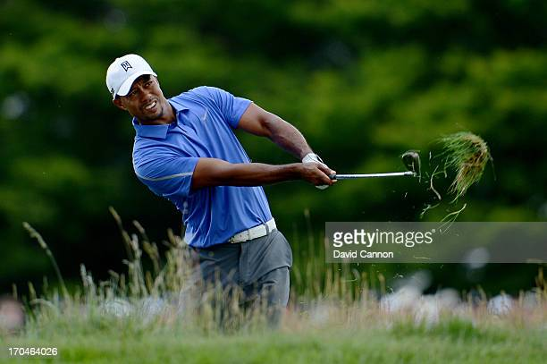 Tiger Woods of the United States hits his second shot on the first hole during Round One of the 113th U.S. Open at Merion Golf Club on June 13, 2013...