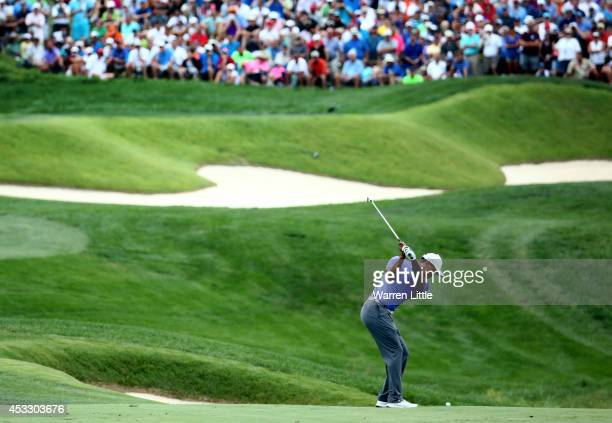 Tiger Woods of the United States hits his second shot on the ninth hole during the first round of the 96th PGA Championship at Valhalla Golf Club on...