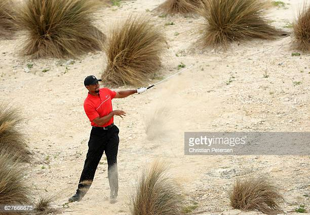 Tiger Woods of the United States hits his second shot on the third hole during the final round of the Hero World Challenge at Albany The Bahamas on...