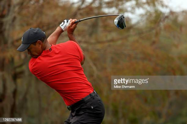 Tiger Woods of the United States hits his tee shot on the 15th hole during the final round of the PNC Championship at the Ritz Carlton Golf Club on...