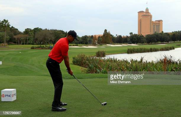 Tiger Woods of the United States hits his tee shot on the 16th hole during the final round of the PNC Championship at the Ritz Carlton Golf Club on...