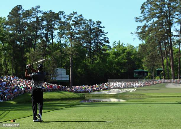 Tiger Woods of the United States hits his tee shot on the 16th hole during the third round of the 2015 Masters Tournament at Augusta National Golf...