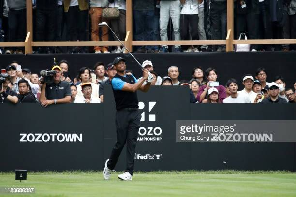 Tiger Woods of the United States hits his tee shot on the 18th hole during the third round of the Zozo Championship at Accordia Golf Narashino...