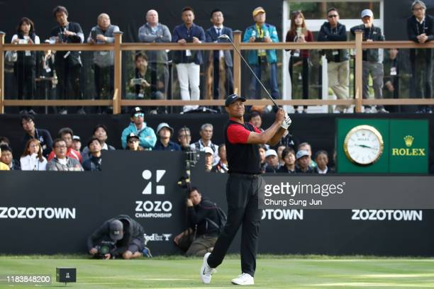Tiger Woods of the United States hits his tee shot on the 18th hole during the final round of the Zozo Championship at Accordia Golf Narashino...