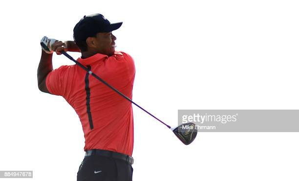 Tiger Woods of the United States hits his tee shot on the 18th hole during the final round of the Hero World Challenge at Albany Bahamas on December...
