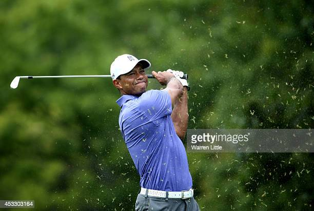 Tiger Woods of the United States hits his tee shot on the eighth hole during the first round of the 96th PGA Championship at Valhalla Golf Club on...