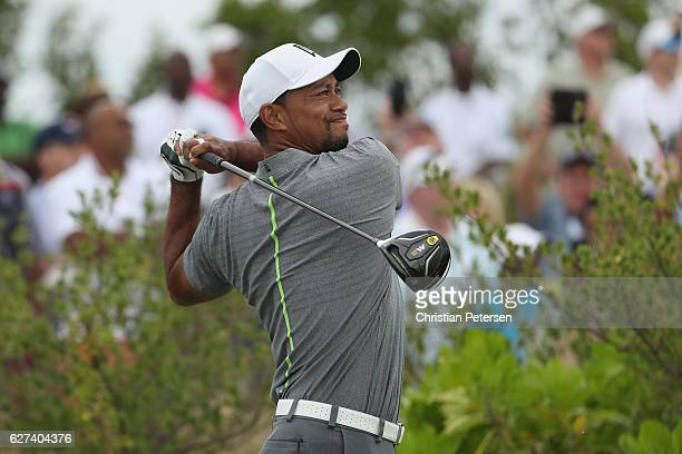 Tiger Woods of the United States hits his tee shot on the first hole during round three of the Hero World Challenge at Albany The Bahamas on December...