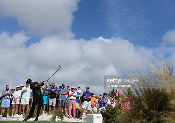 Tiger Woods of the United States hits his tee shot on the fourth hole during round one of the Hero World Challenge at Albany The Bahamas on December...