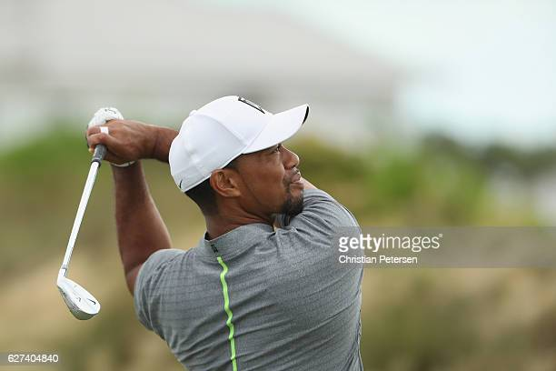 Tiger Woods of the United States hits his tee shot on the second hole during round three of the Hero World Challenge at Albany The Bahamas on...