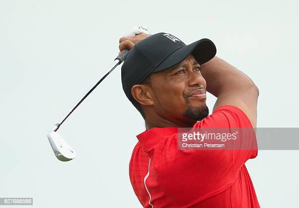 Tiger Woods of the United States hits his tee shot on the second hole during the final round of the Hero World Challenge at Albany The Bahamas on...