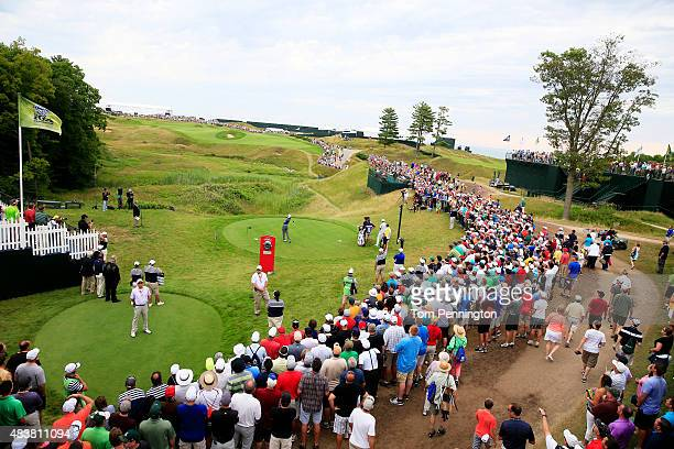 Tiger Woods of the United States hits his tee shot on the tenth hole during the first round of the 2015 PGA Championship at Whistling Straits on...