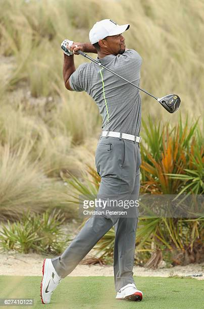 Tiger Woods of the United States hits his tee shot on the third hole during round three of the Hero World Challenge at Albany The Bahamas on December...