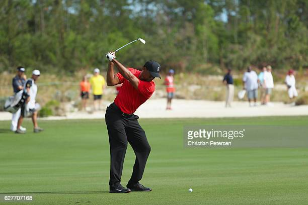 Tiger Woods of the United States hits his third shot on the 11th hole during the final round of the Hero World Challenge at Albany The Bahamas on...